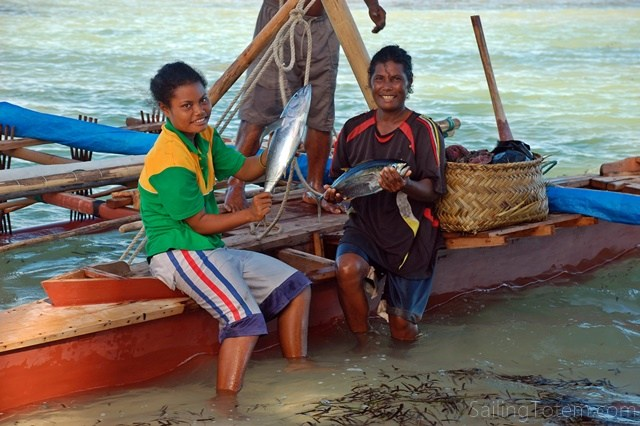 This family just sailed outrigger back from their vegetable garden, an overnight trip in open ocean